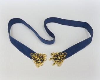 Blue elastic waist belt. Gold filigree buckle. Navy blue dress belt.