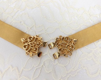 Gold elastic waist belt with filigree clasp, available in regular and plus size
