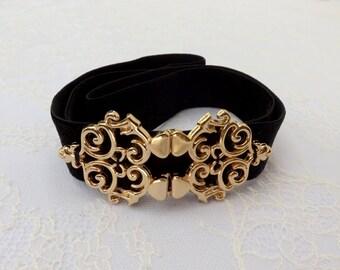 Black elastic velvet waist belt. Gold filigree buckle. elegant elastic waist belt.