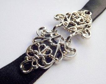 Black elastic waist belt. Filigree silver buckle. Elastic dress belt. Elegant evening belt.