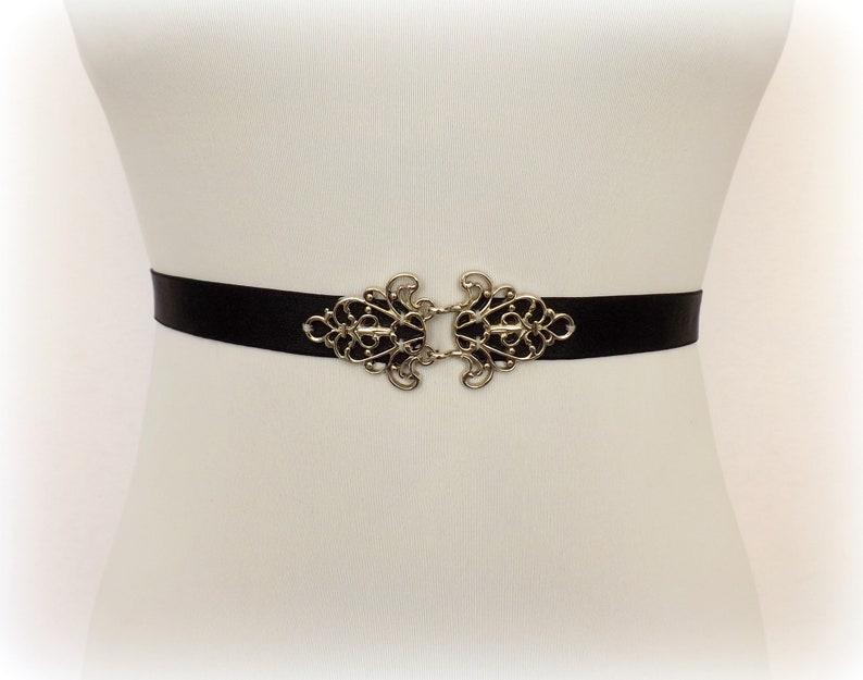 Black elastic waist belt with silver filigree clasp