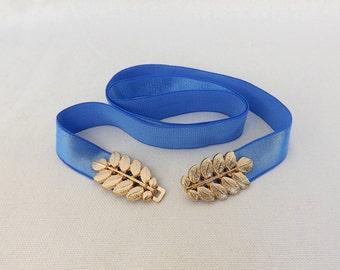 Royal blue elastic waist belt. Gold leaf buckle. Stretch dress belt.