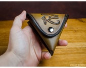 Eye of Horus leather coin...