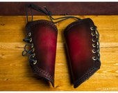 Pair of lined red leather...