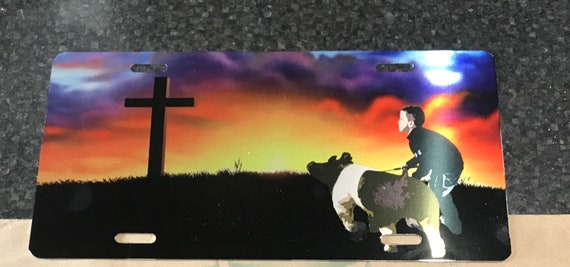Driving to the cross pig car tag
