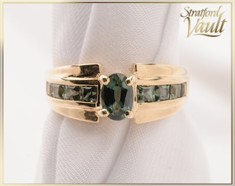 Ladies Green Sapphire Ring ~ 14K Yellow Gold ~ 0.60ct Created Oval Sapphire ~ 0.40ctw Created Princess Sapphires ~ STR21096