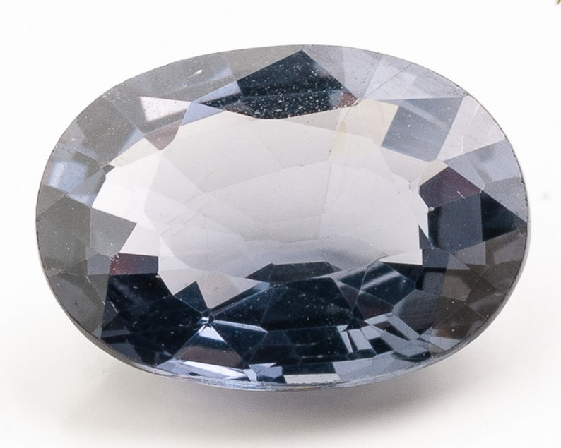 Oval faceted Dark Grey Blue Natural Spinel  8.52 x 6.19 x image 0