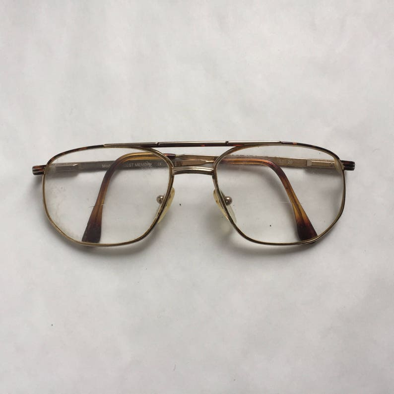 511f5e194b4 80 s Woman Old round glasses Brown gold metal Vintage