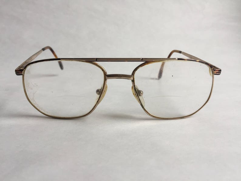 bcc89eccb1 80 s Woman Old round glasses Brown gold metal Vintage