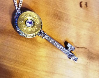 Blinged out silver key made with spent ammunition!