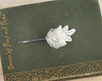 Floral Wedding Hair Clips for a bride or bridesmaid. A dainty vintage style white flower with beaded lace leaves on a hair grip