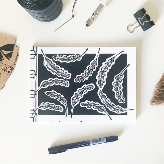 Handmade binded notebook, A5 horizontal, laiepi graphic