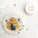 needle minder, beehive needle nanny, pin cushion, cross stitch, fridge magnet, bees and beehive, crochet tools, cross stitch accessories