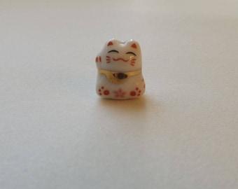 Small Porcelain Cat Bead - With pink Flower - Maneki Neko - Beckoning Cat, Lucky Cat - Raised Paw