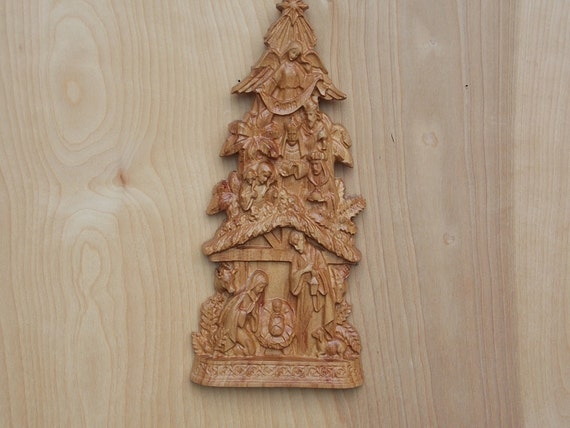 Cut out wooden pine on tinsels background carved wooden