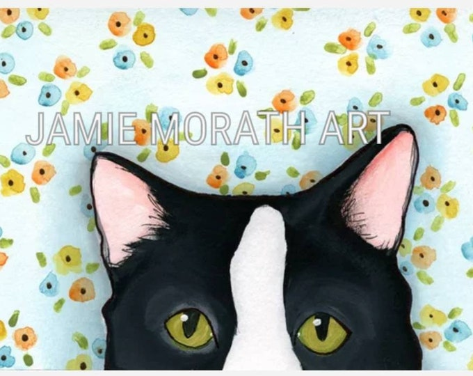 You're Being Watched (white), black and white tuxedo cat peeking over the edge with light blue background with flower pattern, green cat eye