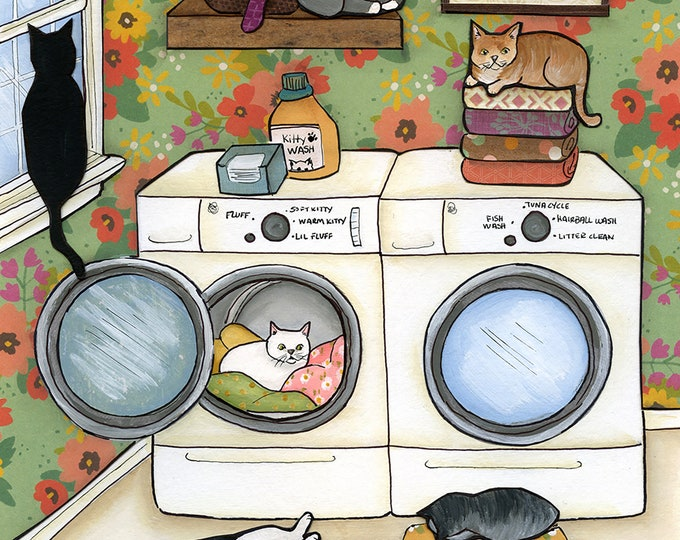 Featured listing image: Little Ball of Fur, Cats in the laundry room, snuggling in warm blankets, Cat on folded towels.