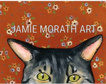 You're Being Watched (orange), grey tabby cat peeking over the edge, burnt orange background with flower pattern, green cat eyes
