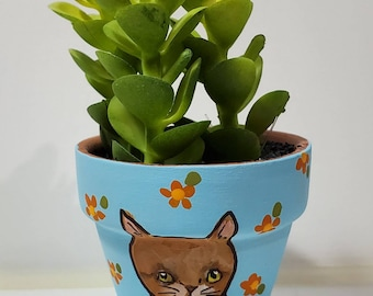 Orange Tabby planter with artificial succulent