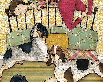 Coonhound Cuddles, three coonhounds on a bed with lady sleeping on the headboard