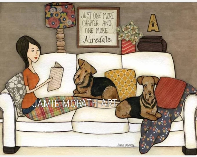 One More Airedale, just one more chapter and one more airedale, lady sitting on couch with dogs reading books, dog art print, ornaments