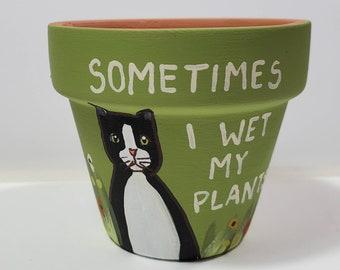 Green Wet My Plants clay pot