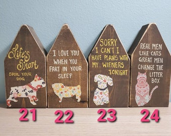 Wooden dog houses with silhouette and handwritten quotes