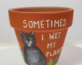 Orange Wet My Plants pot