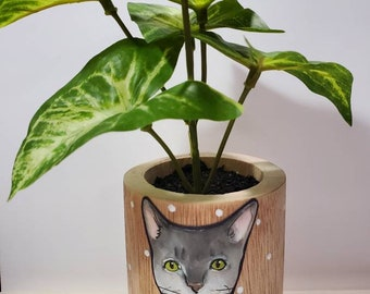 Gray cat wooden planter with artificial plant