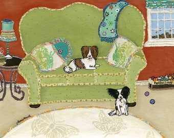 Papillion Love, green couch with papillion dogs in family room, wall art print, butterfly pillow and rug, brown and white black