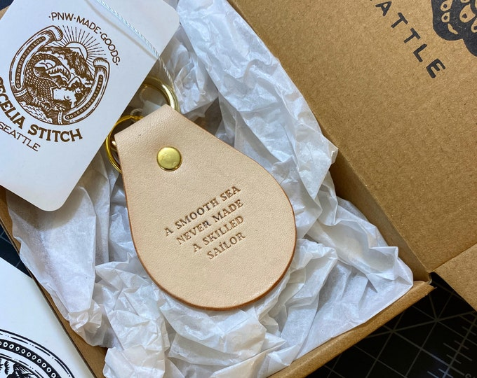 A smooth sea never made a skilled Sailor - Leather & Brass Key fob