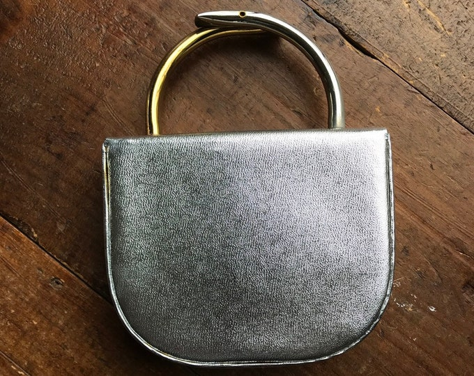 1960s Silver Metallic Clutch by Arnold Scaaci. Silver Lame Handbag with Altering Gold and Silver Handles.