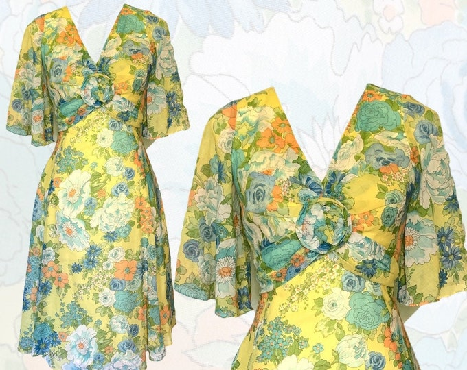 1960s Floral Summer Midi Dress by Miss Elliette with a Green, Blue and Yellow Floral Design. Perfect for a Vintage Wedding or Festival Dress