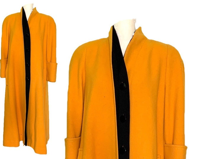 1980s Yellow Wool Coat by Ilie Wacs for Saks Fifth Avenue. Bold and Oversized with Black Collar and Button Accents.