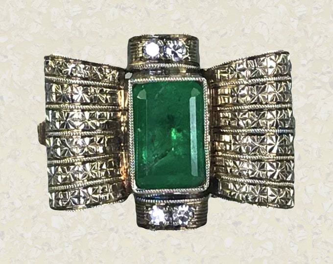 1920s Art Deco Emerald and Diamond Cocktail Ring in an 18K Gold Bow Tie Setting. Unique Engagement Ring. May Birthstone.