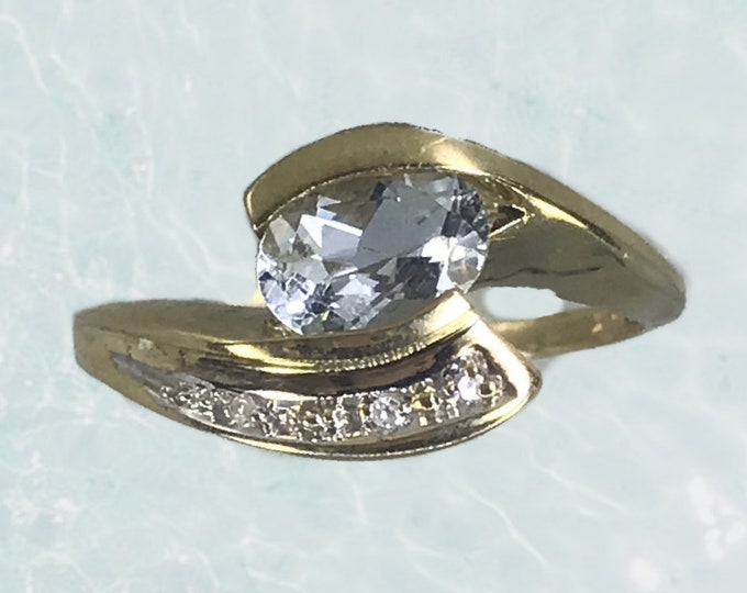 1970s Aquamarine and Diamond Ring in a Modernist 10k Yellow Gold Bypass Setting. Unique Engagement Ring. March Birthstone.