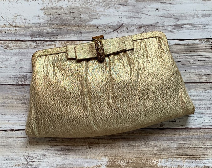 1960s Gold Lame Clutch with Rhinestone Bow Closure. Perfect Metallic Statement Accessory of Sustainable Vintage Fashion.