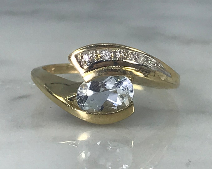 Vintage Aquamarine Diamond Ring. Modernist 10k Yellow Gold Bypass Setting. Unique Engagement Ring. March Birthstone. 19th Anniversary Gift.