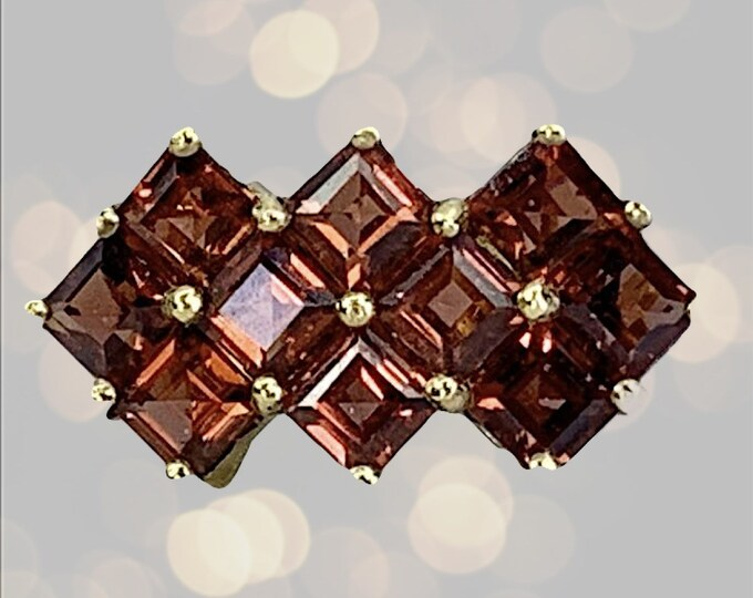 1970s Garnet Cluster Ring set in 10k Yellow Gold. This Geometric Statement Ring is January Birthstone in Old Hollywood Glam Style.