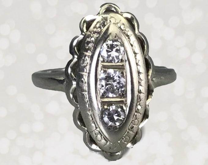 Vintage Diamond Ring in a 14K White Gold Shield Style Setting. 1940s Sustainable Vintage is Perfect for a Unique Engagement Ring.