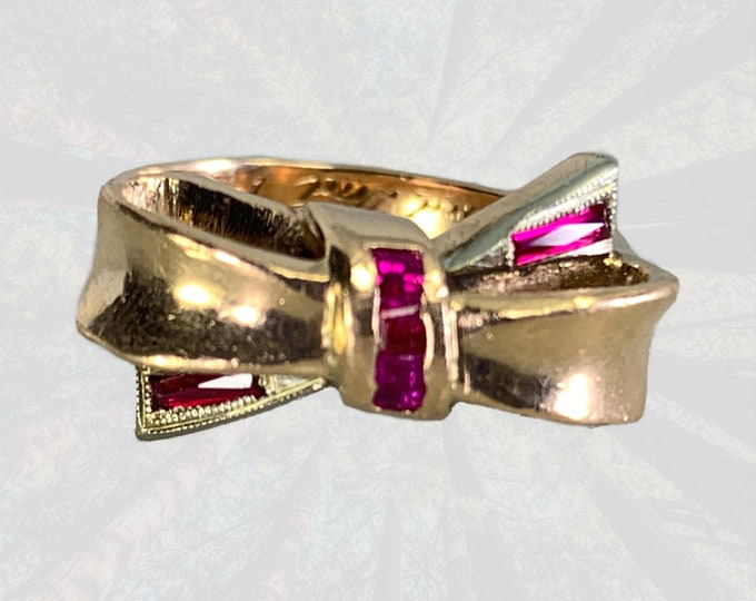 Vintage Ruby Bow Shaped Ring set in 14K Yellow Gold. July Birthstone. 1940s Sustainable Estate Jewelry with Hollywood Glamour Design.