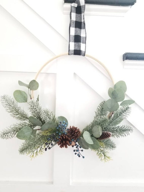 Silver White Winters Hoop Wreath with eucalyptus, silver pine, and berries in blue