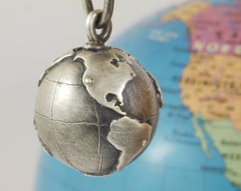 Pendant Globe silver with gold dot for your favorite place