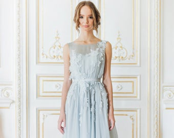 Sleeveless blue wedding gown with floral lace appliques floating down the bodice // Vergy wedding dress