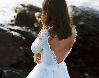 Off-white open back boho wedding gown with flowing skirt