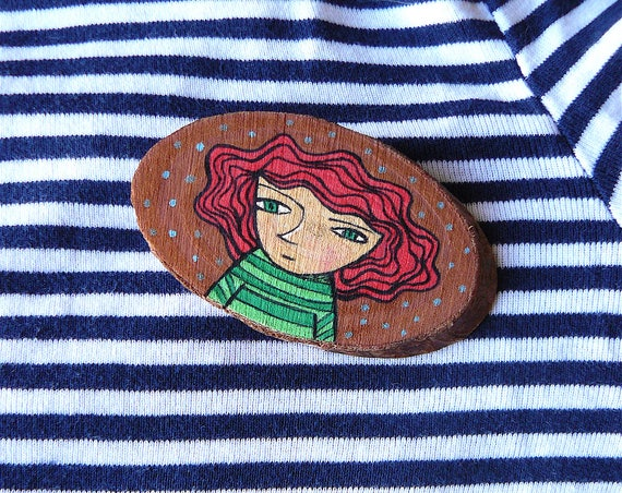 Brooch made in wood. Hand painted portrait of woman. 7 x 4 cm.