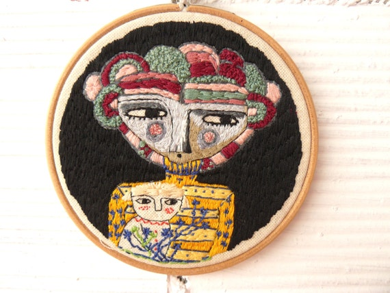 Mother with her daughter hand embroidery in wooden hoop