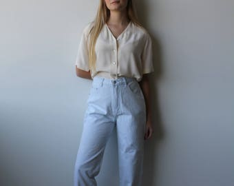 vintage high waisted jeans | light wash mom jeans | deadstock vintage denim | Able Shoppe