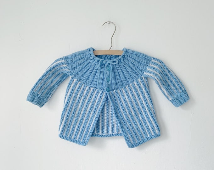 Hand knit baby sweater