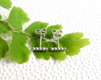 Small minimalist beaded wire bar studs in sterling silver